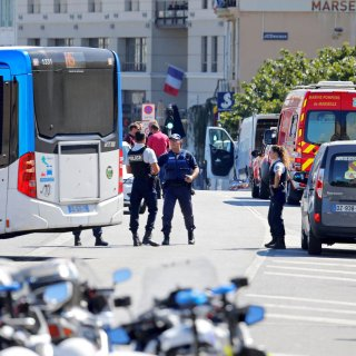 French police secure the area in the French port city of Marseille, France, August 21, 2017 where one person was killed and another injured after a car crashed into two bus shelters, a French police source told Reuters on Monday. REUTERS/Philippe Laurenson